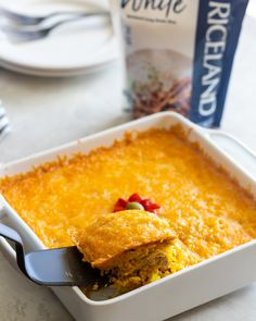A classic Cuban comfort food dish made with layers of yellow rice, shredded chicken, mayonnaise, and melted cheese. Rice Dishes, Food Dishes, Canned Tomato Sauce, Best Comfort Food, Saute Onions, Melted Cheese, Yum Yum Chicken, Shredded Chicken, Rotisserie Chicken