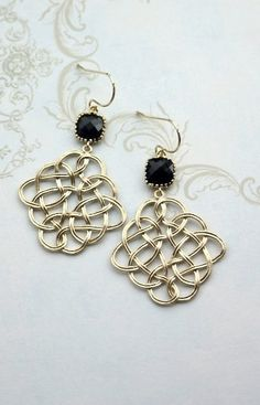 Black and Gold Filigree Feather Chandelier Earring, Black Gold Chandelier Dangle Earrings. Black Wedding. Bridesmaids Gift, Black and Gold Earrings, by MAROLSHA - https://www.etsy.com/listing/231986164/jet-black-gold-filigree-feather?ga_search_query=black&ref=shop_items_search_93