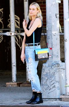 Destroyed denim boyfriend jeans paired perfectly with booties // #StreetStyle #Casual