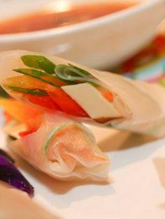 great vegan cocktail appetizer treat - vietnamese rice paper rolls with ponzu baked tofu, asian herbs, green papaya.