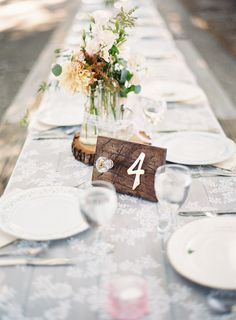 Using a wooden plank as table number is truly amazing and suits well for rustic vintage weddings - Wooden Wedding Table Number Ideas