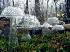 Glass mushrooms for the garden made from recycled vases and crystal bowls.