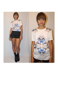 Its a mirror image thing! Beautiful, casual print blouse! Satin and cotton for a comfy feel...  it