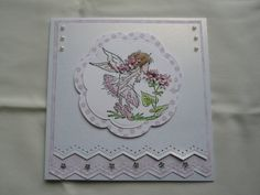 LOTV stamp coloured with Pro-markers matted on Spellbinders blossom die cuts. Martha Stewart edge punch used on matts. Decorated with flat back pearls and crystal gems