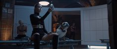 """Pin for Later: See Every Fierce Look From Taylor Swift's """"Bad Blood"""" Music Video  Gigi Hadid, looking as fierce as ever in a sexy set and some boots."""
