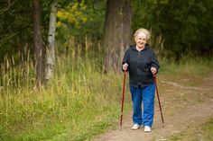Elderly woman engaged in Nordic walking in the Park.