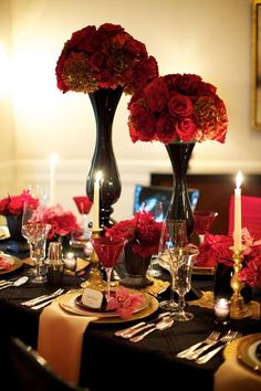 Gold, black, and red wedding reception with tall rose centerpieces - so romantic…