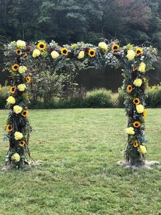 An outdoor wedding arch full of sunflowers, eucalyptus, hydrangea and roses. #weddingarch #bridalarch #archflowers #weddingflowerarch #organicarch #sunflowers #sunflower #sunflowerwedding #outdoorwedding #organicwedding #princeton #princetonwedding #mountainlakeshouse