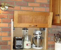 Modern Moroccan Kitchen by Kitchen & Bath Works www.kandbworks.com Appliance storage