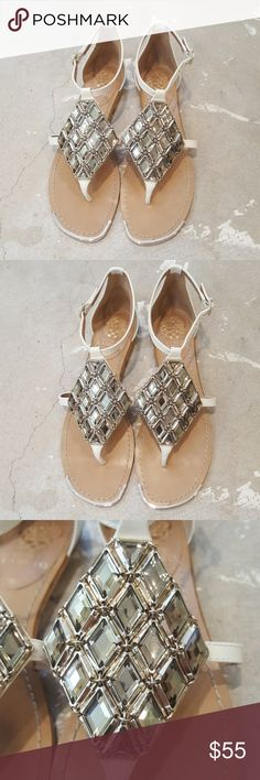 Vince Camuto Medalion Crystal Sandals I am selling a breathtaking and chic pair of Vince Camuto Sandals.  This particular pair of sandals has smoked colored, large crystals which set atop white leather in a large medallion shape.  I have never worn these out, in exceptional condition size 8. Vince Camuto Shoes Sandals