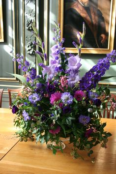 Purple arrangement with Gladioli, scabious and Dahlia.