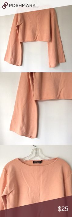 """Nasty gal cropped knit pink bell sleeve sweater By rehab, purchased from nasty gal / cropped heavy knit sweater / peachy pink color / bell sleeves about 22.5"""" from shoulder tip / about 16"""" length from shoulder tip to bottom / 18"""" across bust / worn a few times / perfect condition / size small Nasty Gal Sweaters"""