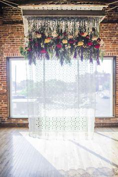 ceremony backdrop with hanging flowers, photo by Hannah Elaine Photography http://ruffledblog.com/the-2nd-notwedding-nashville #weddingceremony #backdrops