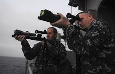 NORTH ARABIAN SEA (July 21, 2013) - Master-at-Arms 1st Class Benjamin Newton, left, native of Days Creek, Ore., and Senior Chief Master-at-Arms Marc Lucas, native of Fishers, Ind., shoot LA-9P Laser Dazzlers during an exercise on the fantail on board the aircraft carrier USS Nimitz (CVN 68).