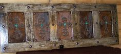 Old door, leather (or tin) inserts, embellish with heavy nail head detail in design of choice. http://crystalcattle.blogspot.ca/2010/06/turquoise-thursday.html