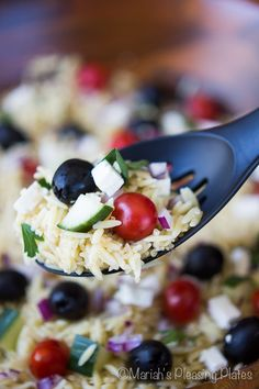 This Simple Greek Orzo and Quinoa Salad with Lemon Vinaigrette is the perfect, healthy side dish for dinners, parties or potlucks! Filled with the delicious Mediterranean flavors of jumbo California Black Olives, salty feta cheese and juicy cherry tomatoes, this salad is great every day of the week.