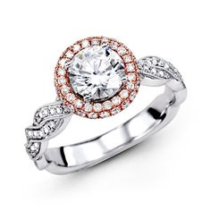 This gorgeous 18K rose and white engagement ring is comprised of .51ctw round white Diamonds.    MR2133