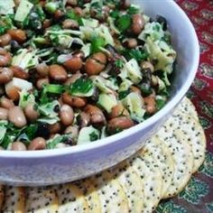 "White Bean and Artichoke Salad | ""Next time I may add slivered Kalamata olives instead of ripe olives, hmm...and maybe some crumbled feta on top, too. A family member suggested I toss in some diced cucumber, too."""