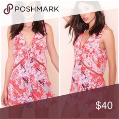 NWT free people grapefruit romper Beautiful and soft to touch 100% rayon Free People Dresses