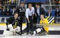 Prince Harry drops the puck in as Canadian Prime Minister Justin Trudeau looks on as they start a sledge-hockey match Mattany at the Athletic Centre on May 2, 2016 in Toronto, Canada. Prince Harry is in Toronto for the Launch of the 2017 Toronto Invictus Games before heading down to Miami and the 2016 Invictus Games in Orlando.  (Photo by Chris Jackson/Getty Images)