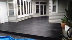 Merbau deck sanded then oiled using Black Japan pigment then finished with Clear