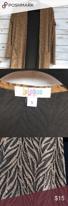 Small Lularoe Sarah, extra stretchy material Small Sarah cardigan. Brown with black liner. This material is very stretchy (so it can fit a bigger arm), but maintains its shape (so it won't drag on the ground by the end of the day.   Slight pilling pictured in 3rd photo, can be easily trimmed. LuLaRoe Sweaters Cardigans