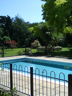 Bowtop fencing around swimming pool