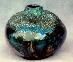 M.Wein Raku ,Hi fire Functional {will hold Water] fired to Cone 10 and refired to 1100 Raku Black Japanese clay some re oxidation