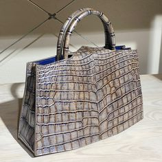 @barwa_kw has completed her bag and it looks amazing! Distressed metallic crocodile with blue goat skin lining. what do you think guys? How'd she do? This is her own design as well