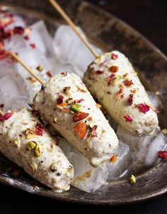 How do you like these rich, creamy and delicious malai coated kulfis. With full of thandai flavor and slivered nuts, these thandai kulfis are the best ever thing you will make this summer!  Recipe @ http://cookclickndevour.com/thandai-kulfi-recipe-holi-2017-recipes
