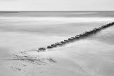 Silence - Zingst - Germany - Beach of Zingst - East Sea - Germany The sea was very calm and little waves wrapped themselves around the wooden poles Wooden Poles, Baltic Sea, Germany, Waves, Calm, Abstract, Beach, Artwork, Photography