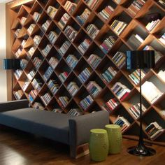 Home Libraries: Creative ways to organize books using varying design element, materials, natural light and spatial programming.