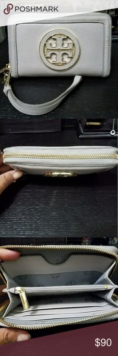 Tory Burch Smartphone Wristlet Wallet Used but in very good condition. No stains, marks, tears, or noticeable  creases.  Zipper is smooth. It fits a Samsung Galaxy S7 with a tgin case snugly.  Color: French Grey  4 x 6 x 1 Bags Clutches & Wristlets