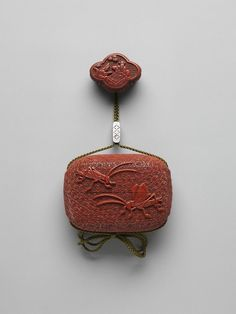 Case (Inrō) with Design of Crickets , Artist:Onko Takanaga (dates unknown), Edo period (1615–1868), Date:19th century, Culture:Japan Case: carved red lacquer; Fastener (ojime): silver with openwork slide; Toggle (netsuke): red lacquer carved in the shape of a lobed table with two gentlemen playing a game of go