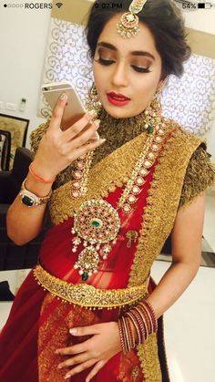 Beautiful Bride in a Red Saree with Gold Jewelry