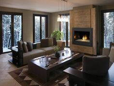 Beautiful #fireplace and furnishings in this very modern open concept living room.