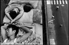 Photography by Chien-Chi Chang. Immigrants sleeping in New York City, 1998.