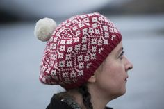 This hat is the 101st pattern for hand-knitting that I have designed and published. It is a sampler of many things I enjoy about making stranded hats: simple two-colour knitting, small interconnected motifs, centred double decreases, a pleasing crown pattern and an accommodating shape that can be blocked into a tam. I hope you enjoy it.