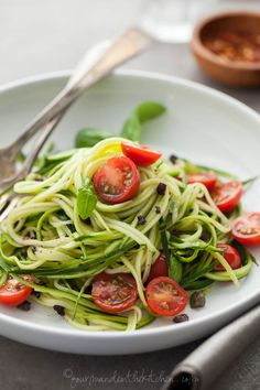 Zucchini Noodles with Caper Olive Sauce and Fresh Tomatoes gourmandeinthekitchen.com