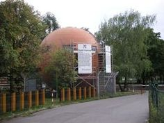 Republic of Kugelmugel, a ball-shaped house built by artist (and Kugelmugel President) Edwin Lipburger. Unfortunately, the border's closed; you won't get past the barbed wire fence.
