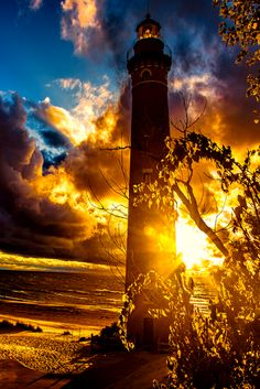 """""""This one is a light in the almost darkness....amazing sunset behind a lighthousex (quote)"""