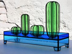 These glass cactuses are *beautiful*, I love what stained glass does with daylight!