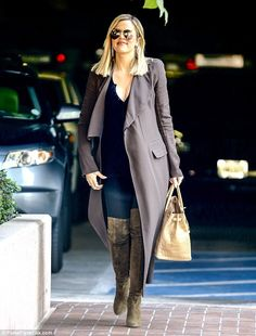 Still haute: Khloe was last seen heading to a business meeting on Monday. The reality princess showed off lean legs in a pair of skinny jeans with kinky boots and a long mauve coat