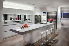 Make your kitchen seem larger and brighter by using a mirror backsplash in your kitchen. Here are several ideas to help inspire you on how to use this trend. Home Decor Kitchen, Kitchen Living, New Kitchen, Home Kitchens, Kitchen Island, Small Kitchens, Kitchen White, Outdoor Kitchens, Living Room