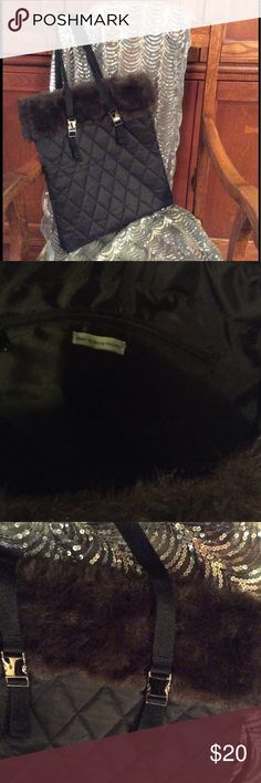 """Faux fur trimmed bag. Never used. Black quilted satin with faux fur trim.  Silver tone buckles on straps.  Buckles work, last picture shows handles buckled across bag instead of buckled on one side as in first pic.  Could then  be worn as small backpack.  13"""" X 15"""". 2 interior slip pockets and 1 zippered pocket.  Never used. Bath and Body Works Bags"""