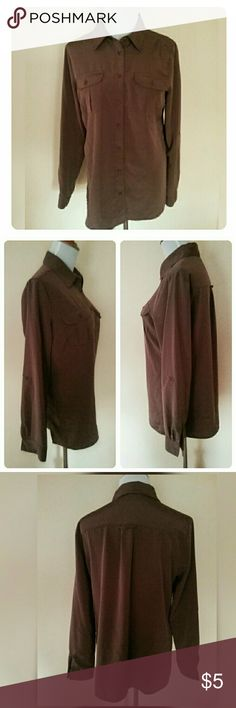 """Notations Shiny Brown Lightweight Blouse This essential button down blouse by Notations can be worn with the sleeves at full length or buttoned up at 3/4 length. There are two front buttoned pockets and two side base slits to be worn untucked as an option. It has been washed but never worn.  It is a size small, but runs large. It is made of 100% polyester and is machine washable.   The measurements across are: shoulder to shoulder 14"""", bust 19 1/2"""". The length is 26 1/2"""" and the arm length…"""