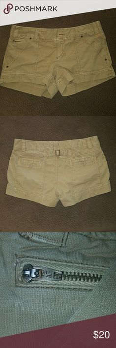 """Tan AE shorts size 14 Khaki shorts size 14. Gently worn, no holes or stains. Laying flat: 18.5"""" across with 3"""" inseam. American Eagle Outfitters Shorts"""