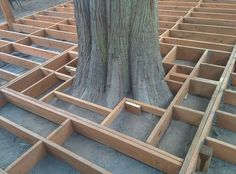DIY - Backyard floating deck built around a tree. Framing around a cedar tree. #deck #tree