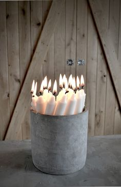 Bucket full of candles: love this! just put a little sand or dirt in the bottom to hold them in place.