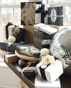 Christmas gift wrap inspiration - black, white and kraft paper with interesting accents from The Nester (lots of great pictures)
